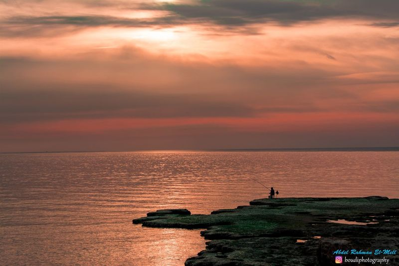 photographer Sea Horizon Over Water Sunset Scenics Water Beauty In Nature Sky Nature Tranquil Scene People Day Outdoors Cloud - Sky Travel Destinations One Man Only Tranquility One Person Vacations Men First Eyeem Photo