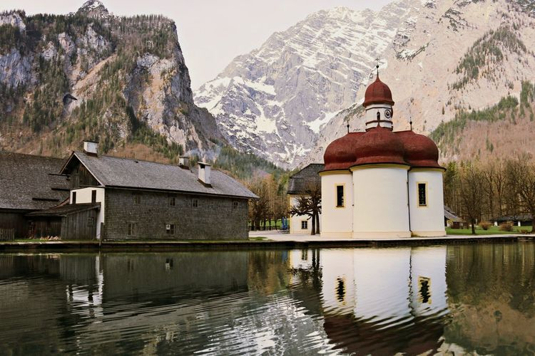 St bartholomew church reflection in konigssee against mountains