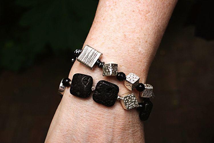 Cropped Hand Wearing Bracelet Against Black Background
