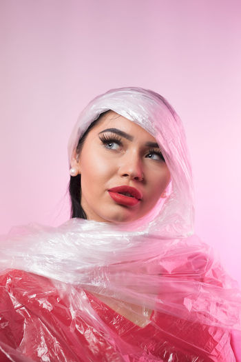 Women Portrait Pink Color Headshot Colored Background Studio Shot One Person Adult Indoors  Young Adult Beauty Beautiful Woman Pink Background Young Women Make-up Fashion Beautiful People Looking At Camera Contemplation Human Face Veil Luxury Hairstyle