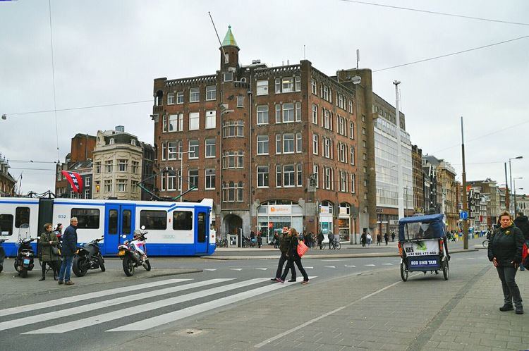 Typical view of amsterdam city with the tram and the bicycle taxi Your Amsterdam Amsterdam Netherlands Symbol Of Amsterdam Amsterdamcity Typical Amsterdam City Of Amsterdam City Life My Hometown Bicycle Taxi Tram My Amsterdam Cityscape City