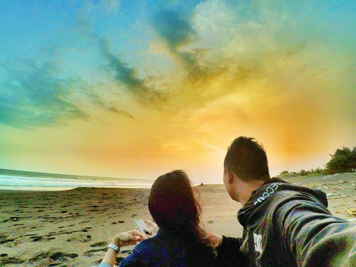 Beach Two People Sea Togetherness Cloud - Sky Sky Nature Photographing Human Body Part Water Lifestyles Adult Sand Sunset Photography Themes People Women