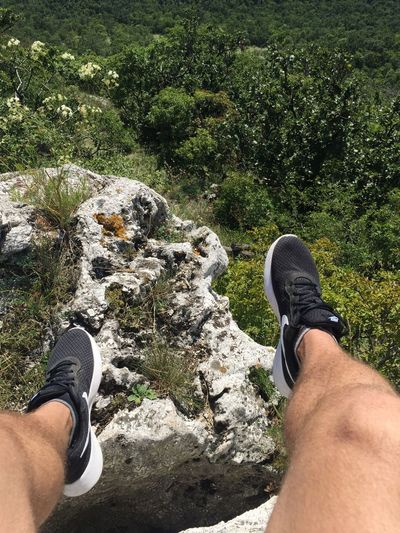 Shoe Real People Lifestyles High Angle View Human Leg Low Section Rock - Object Personal Perspective Human Body Part Leisure Activity Day Outdoors Nature Men One Person Women Beauty In Nature Adult