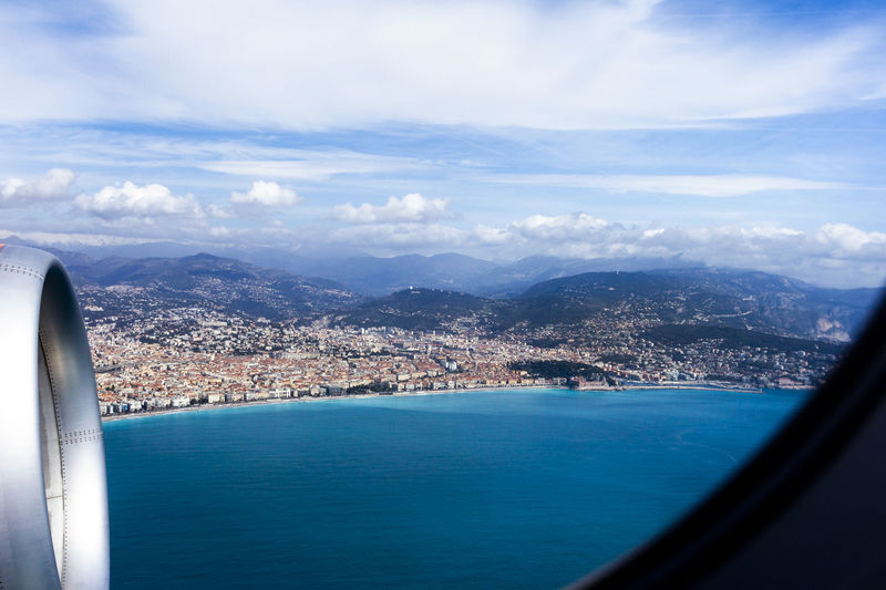 Coastline of Nice, France Cloud - Sky Water Mode Of Transportation Transportation Sky City Architecture Sea Vehicle Interior Airplane Nature Scenics - Nature Beauty In Nature Cityscape Aerial View Building Exterior Air Vehicle Built Structure Outdoors Jet Engine France Nice Coastline Coast Mediterranean