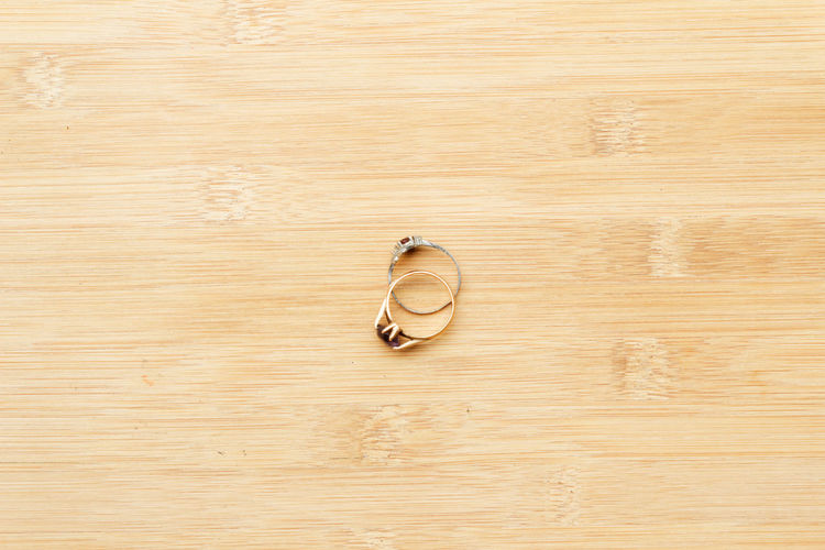 Two rings on wooden background Wooden Wooden Background Background Copy Space Copyspace Decoration Object Engagement Wedding Marriage  Anniversary Texture Wood - Material Jewelry Close-up Personal Accessory Jewellery Wedding Ring Finger Ring Engagement Ring Ring