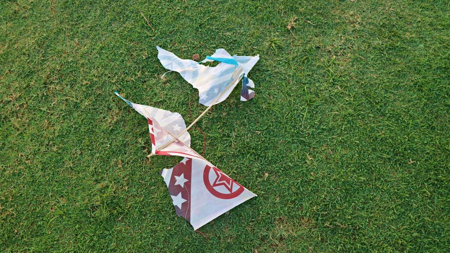 High angle view of paper flag on field