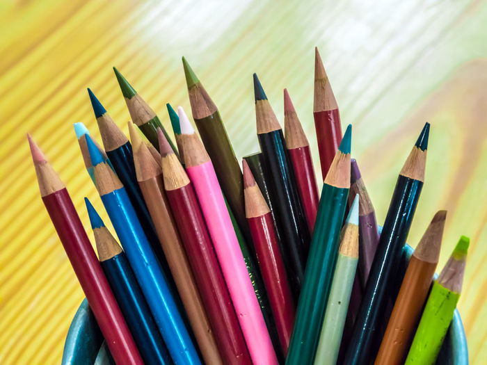 Multicolored pencils are combined in a steel box on a desk in the office. Art Background Blue Bright Brown Closeup College Color Colored Colorful Colors Colour Concept Crayon Crayons Creative Design Draw Drawing Education Equipment Frame Green Group Image Isolated Macro Object Office Orange Paint Palette Pen Pencil Pencils Rainbow Red Row School Set Sharp Stationery Supplies Up Variation Vector White Wood Wooden Yellow Multi Colored Art And Craft Writing Instrument Still Life Choice Large Group Of Objects Close-up No People Craft Indoors  Colored Pencil Creativity Art And Craft Equipment Wood - Material Side By Side High Angle View Vibrant Color Focus On Foreground Variety Self Improvement