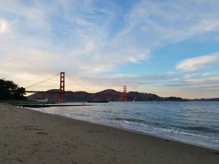 Beach Sand Travel Destinations Outdoors Sunset Cloud - Sky Bridge - Man Made Structure Water No People Tranquility Landscape Architecture Nature San Francisco Bay Waters Clear Sky Tranquility Scenics Purist No Edit No Filter Lost In The Landscape Tranquil Scene San Francisco Ca No Filter/no Edit Suspension Bridge Architecture Golden Gate Bridge
