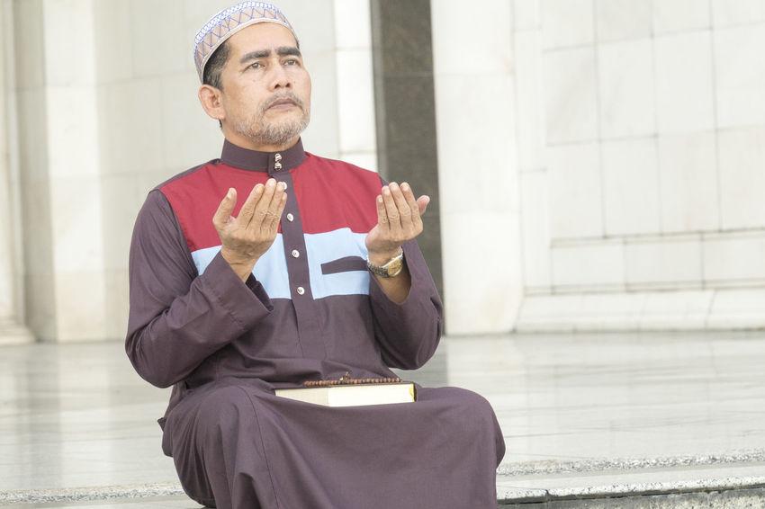 Middle age muslim man praying at mosque. Eid Mubarak Muslims One Person Only Ramadan Mubarak Deeds Devotees Islam Islamic Mosque Muslim One Person Praying Wholeheartedly