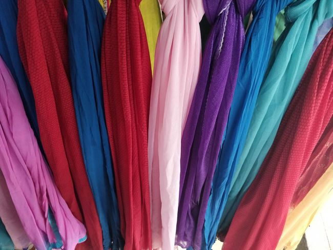 Multi Colored Variation Choice Textile Retail  Full Frame Store Hanging Clothing No People Market Backgrounds For Sale Close-up Shopping Indoors  In A Row Collection Still Life Large Group Of Objects Retail Display Consumerism Scarf