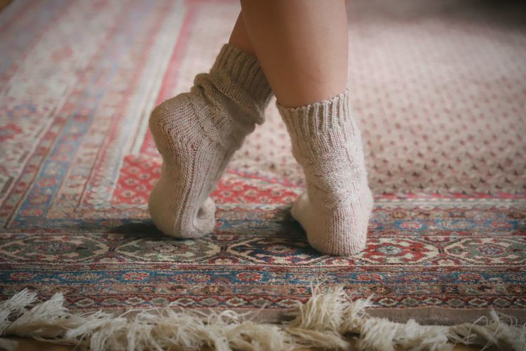 Low section of woman walking on rug