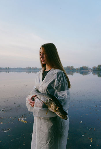 Water Women Nature Young Women Beautiful Woman Outdoors Fish Fishing Nature Weird Beauty In Nature Morning Morning Sky Sky Young Adult Clear Sky Real People Girls Portrait Portrait Of A Woman Jackfish Aniamls Pond Lake Lake View