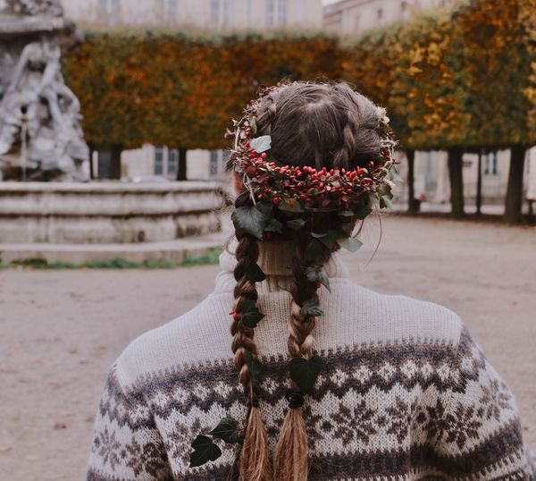 Rear View Of Young Woman Wearing Wreath Against Autumn Trees