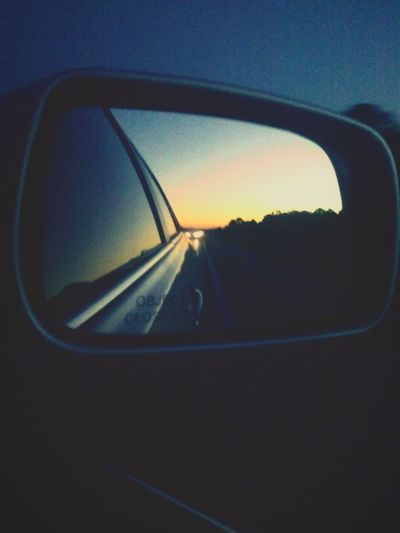 Sunset through a car mirror Artsy