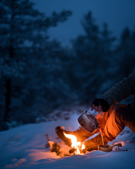 Coffee from a wood fire in the forest at winter.