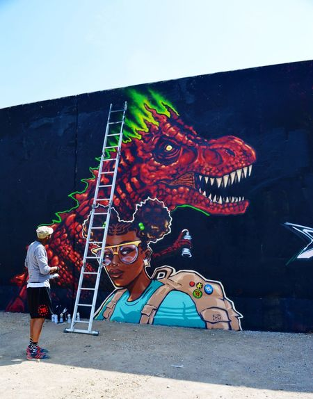 Paint Louis 2016 Mo Colors Vibrant Hanging Out Taking Pictures Enjoying The Moment Artist Point Of View Artists At Work Flood Wall Graffiti Art Art Dinosaur TRex  Girl