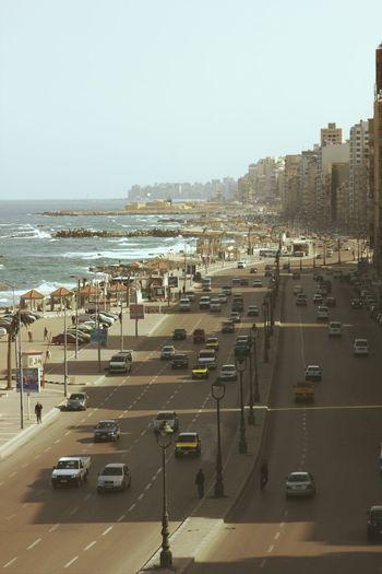 The sea road,Alexandria,Egypt Egypt Alexandria Road Way Cars Street Cityscapes Architecture ArchiTexture Treavelling Alexandria Egypt Streets People Population Cross Street Autos Sea Beach Sea Front