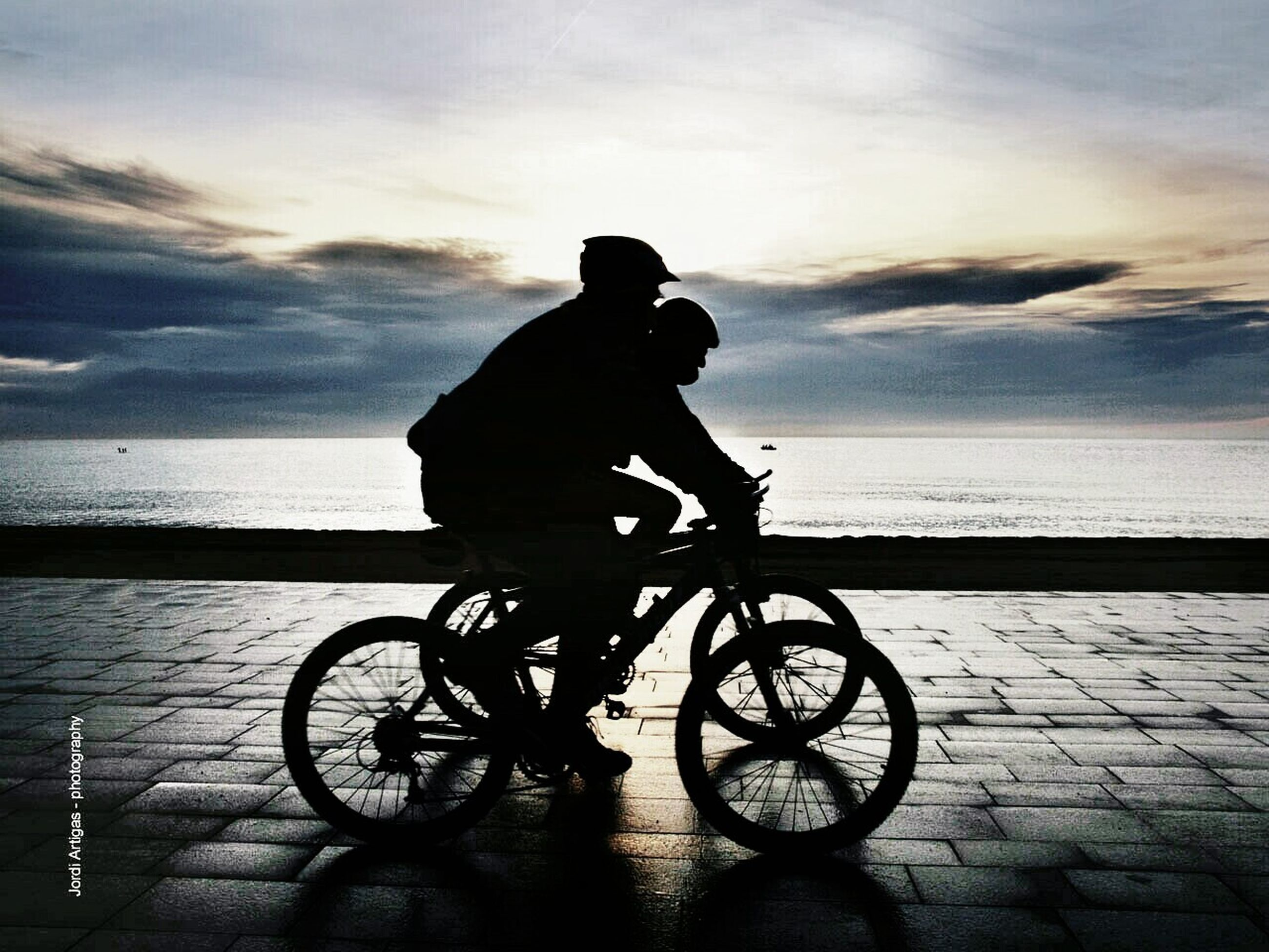 bicycle, sky, silhouette, transportation, sea, mode of transport, sunset, water, men, land vehicle, horizon over water, lifestyles, leisure activity, cloud - sky, riding, full length, beach, side view