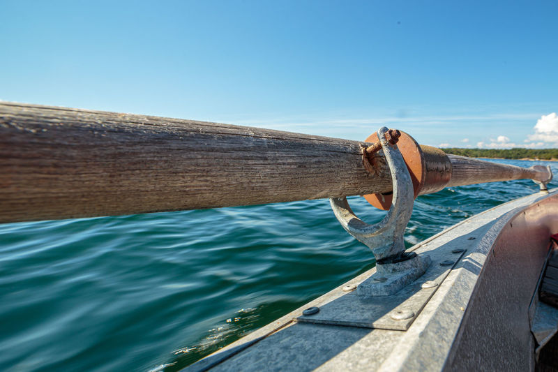 Close up of vintage wooden oars on a aluminum rowboat