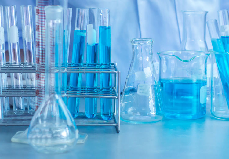 Blue chemical in container at laboratory
