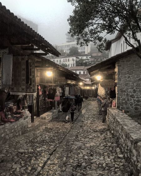 Taking a shower at the Bazar of Kruja Architecturetrip Albania Kruja Bazar Rain Shower Cobblestone Shop Melancholia Dramatic Wet The Architect - 2016 EyeEm Awards The Street Photographer - 2016 EyeEm Awards Feel The Journey Original Experiences