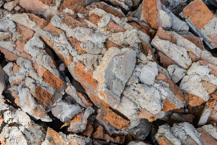 Brick wall, part of a house being demolished. Backgrounds Bones Break Brick Building Change Close-up Contractor Demolition Dusk Engineering Fountain Material Morta Outdoors Renewable Energy Renovation Rock - Object Ruins Structure Textured  Wlasba Women Wreckage
