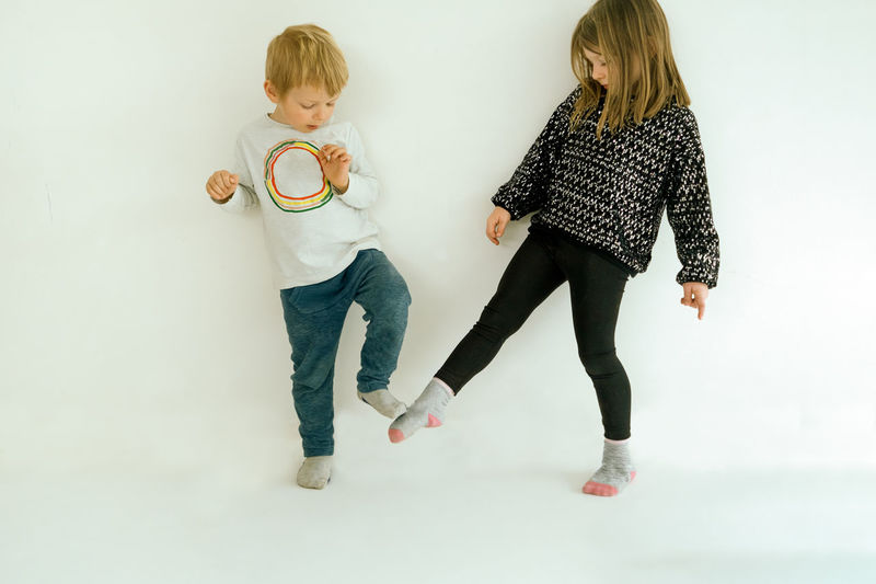 Two children greetings with foot tap - new greets to avoid the spreading of the coronavirus