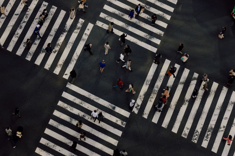 High angle view of people crossing road