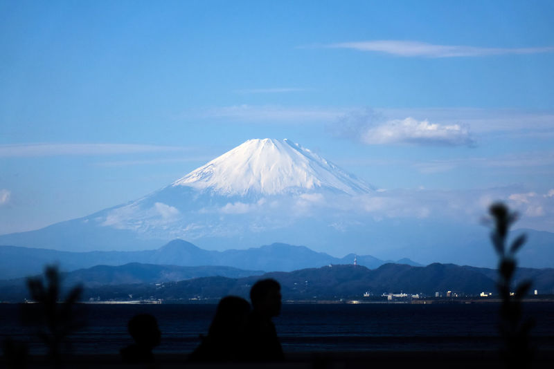 Beauty In Nature Blue Clouds And Sky Cuople Day Focus On Background Idyllic Landscape Mountain Mountain Range Mt. Fuji Nature Non-urban Scene Ocean Outdoors People Scenics Silhouette Sky Snow Snowcapped Mountain Tranquil Scene Tranquility Travel Destinations Water