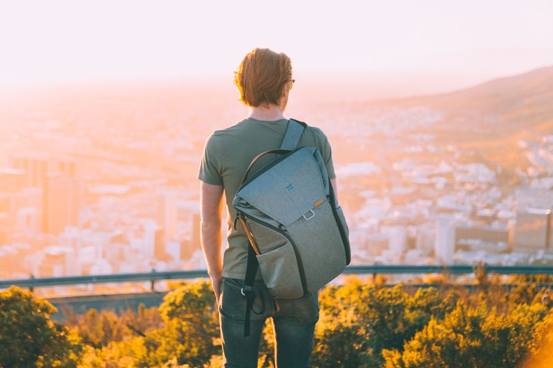 warmth. EyeEmPaid Backpack Travel EyeEm Selects One Person Real People Rear View Leisure Activity Lifestyles Casual Clothing Plant Nature Beauty In Nature Young Adult Sunset Sunlight Outdoors Day Growth