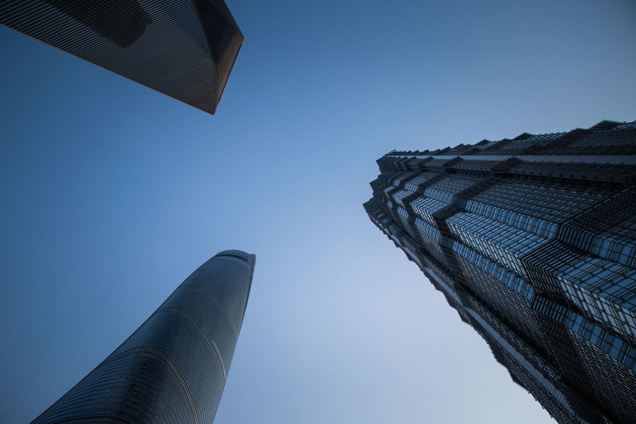 3 Towers Of Shanghai Shanghai Tallest Building In China Architecture Blue Building Building Exterior Built Structure City Clear Sky Copy Space Day Directly Below Low Angle View Nature No People Office Building Exterior Outdoors Sky Skyscraper Spire  Tall - High Tourism Tower Travel Destinations
