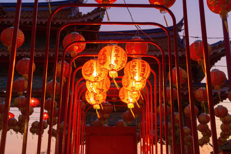 Low angle view of illuminated lanterns hanging in building