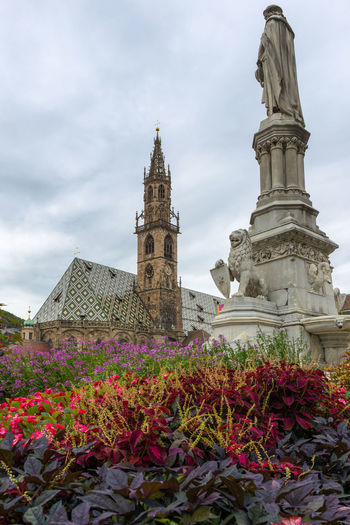 Architecture Building Exterior Built Structure Church Cloud Cloud - Sky Cloudy Day Famous Place Flower Freshness Growth Low Angle View Place Of Worship Plant Religion Sky Spirituality