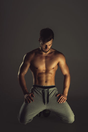 Athletic handsome young man posing in a studio Athlete Athletic Man Masculinity Sportsman Abdomen Abs Attractive Beauty Caucasian Fitness Fitness Model Indoors  Male Muscle Muscular Build One Person People Physique  Sport Sportive Strong Studio Shot Workout Young Adult