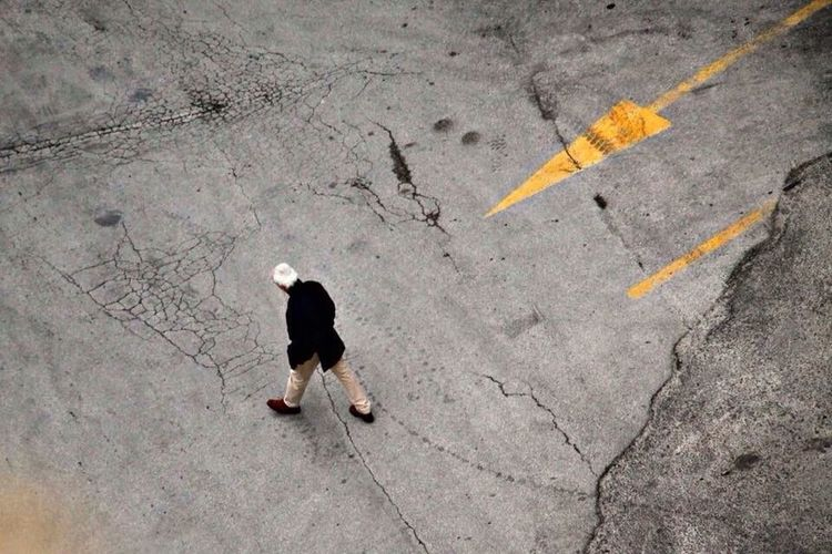 High angle view of people walking on road