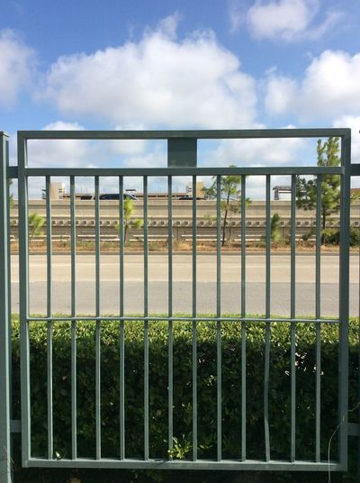 Houston Texas green iron fence Freeway shopping area Blue Sky And Clouds carpark Movie Theatre  Green Hedge