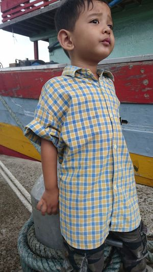 my son See Something Near Ship Near Boat Rope EyeEm Selects Child Childhood Children Only Girls Portrait People One Person Boys Attitude Outdoors Standing Sitting Full Length