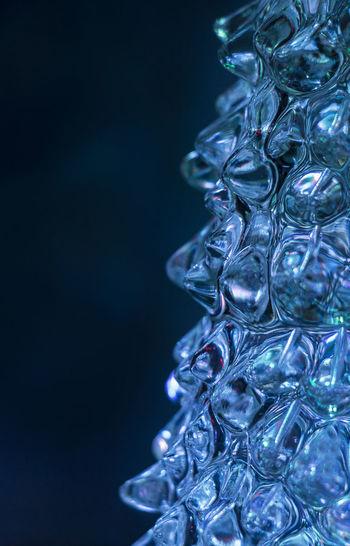 Close-up of blue stack against black background