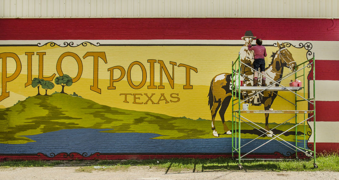 Touching up the paint. Country Paint The Town Yellow Texas Wall Architecture Building Exterior Built Structure Communication Day Graffiti No People Outdoors Painting Pilot Point Rural Scene Text Yellow