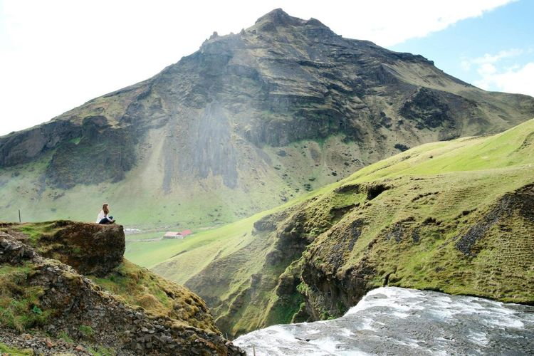 Majestic Iceland Skogafoss Mountain Hiking Adventure Nature Leisure Activity Young Adult Lifestyles Rock - Object One Person Mountain Range Recreational Pursuit Scenics Beauty In Nature Healthy Lifestyle Outdoors One Young Woman Only Mountain Peak Landscape Day Climbing
