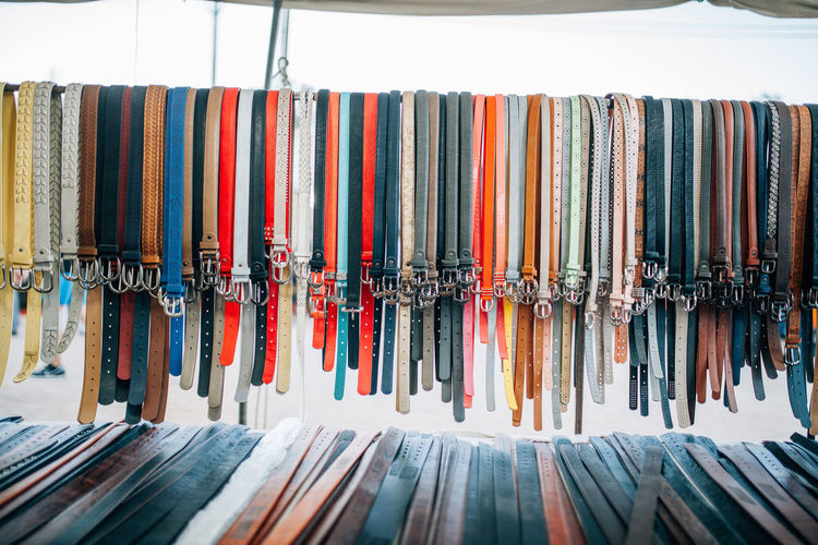 Multi colored belts at market for sale