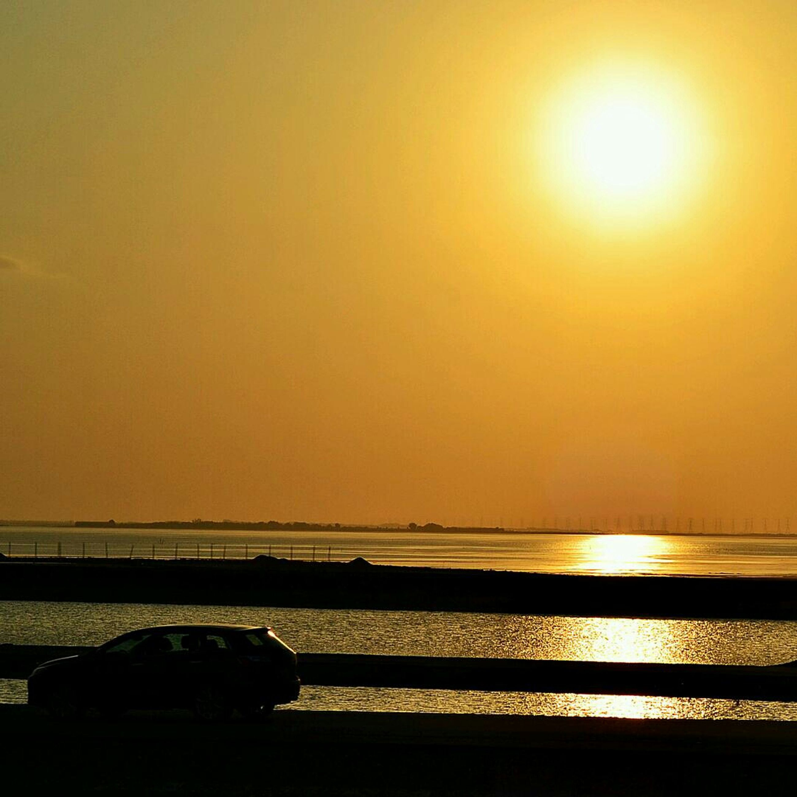 sunset, sun, orange color, sea, clear sky, sunlight, water, scenics, copy space, tranquility, tranquil scene, horizon over water, sunbeam, beauty in nature, lens flare, reflection, nature, transportation, beach, idyllic