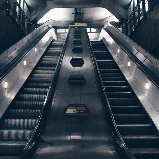 Low Angle View Of Escalators At Underground Station