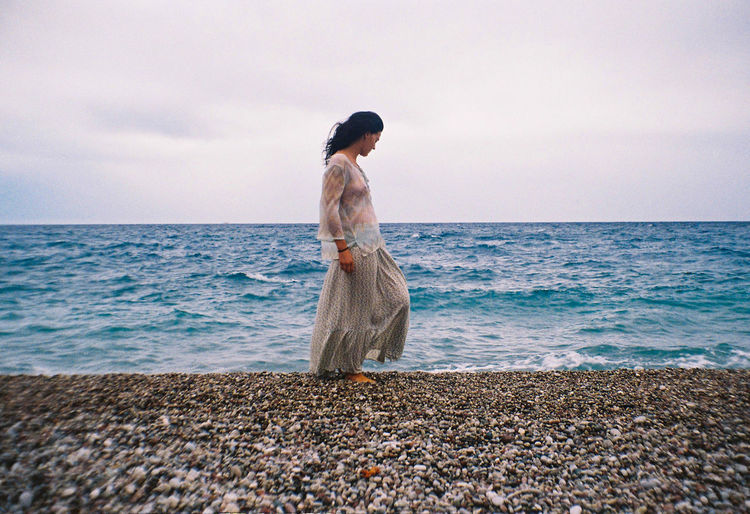 Adult Analogue Photography Beach Beauty In Nature Film Greece Horizon Over Water Long Hair One Person One Woman Only Outdoors Retro Styled Rhodes Sea Sea And Sky Water Weather