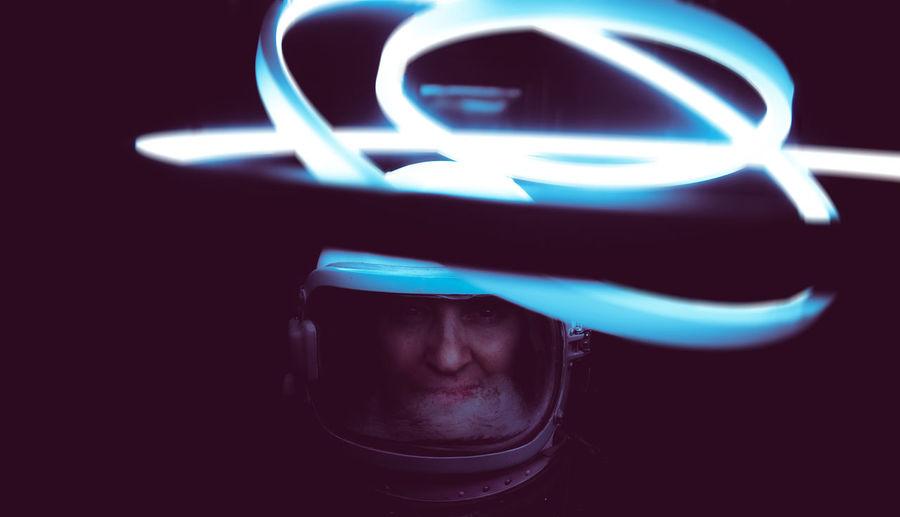 Close-up of astronaut with illuminated lighting equipment