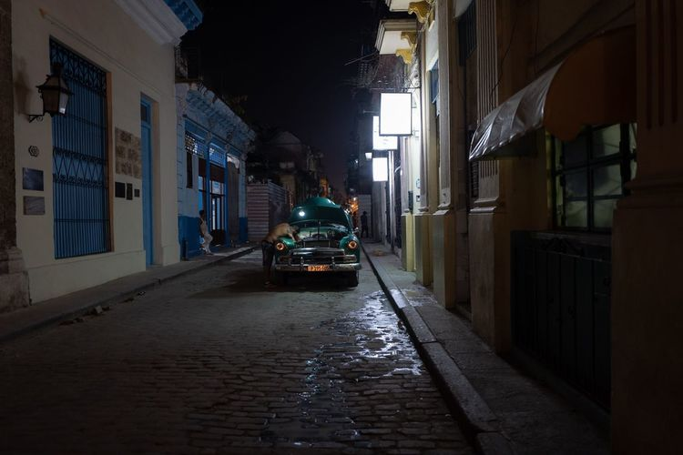 Street amidst buildings in city at night