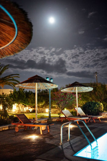 Naxos Night Sky Chair Illuminated Cloud - Sky Nature Night Parasol Moon No People Table Water Seat Absence Swimming Pool Sunshade Pool Lounge Chair Scenics - Nature Shade Outdoors Naxos, Greece Nightphotography Moonlight