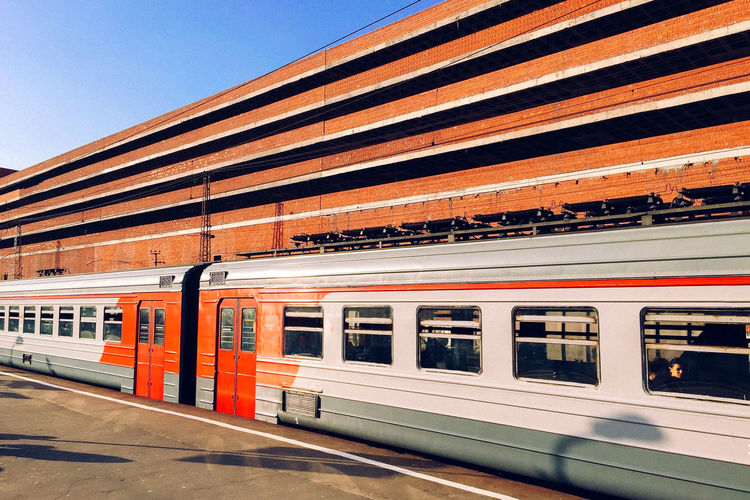 Lines Perspective Architecture Built Structure City Day Geometry Mode Of Transportation Outdoors Passenger Train Public Transportation Rail Transportation Railroad Car Railroad Station Railroad Station Platform Sky Station Subway Train Sunlight Track Train Train - Vehicle Transportation Travel Window