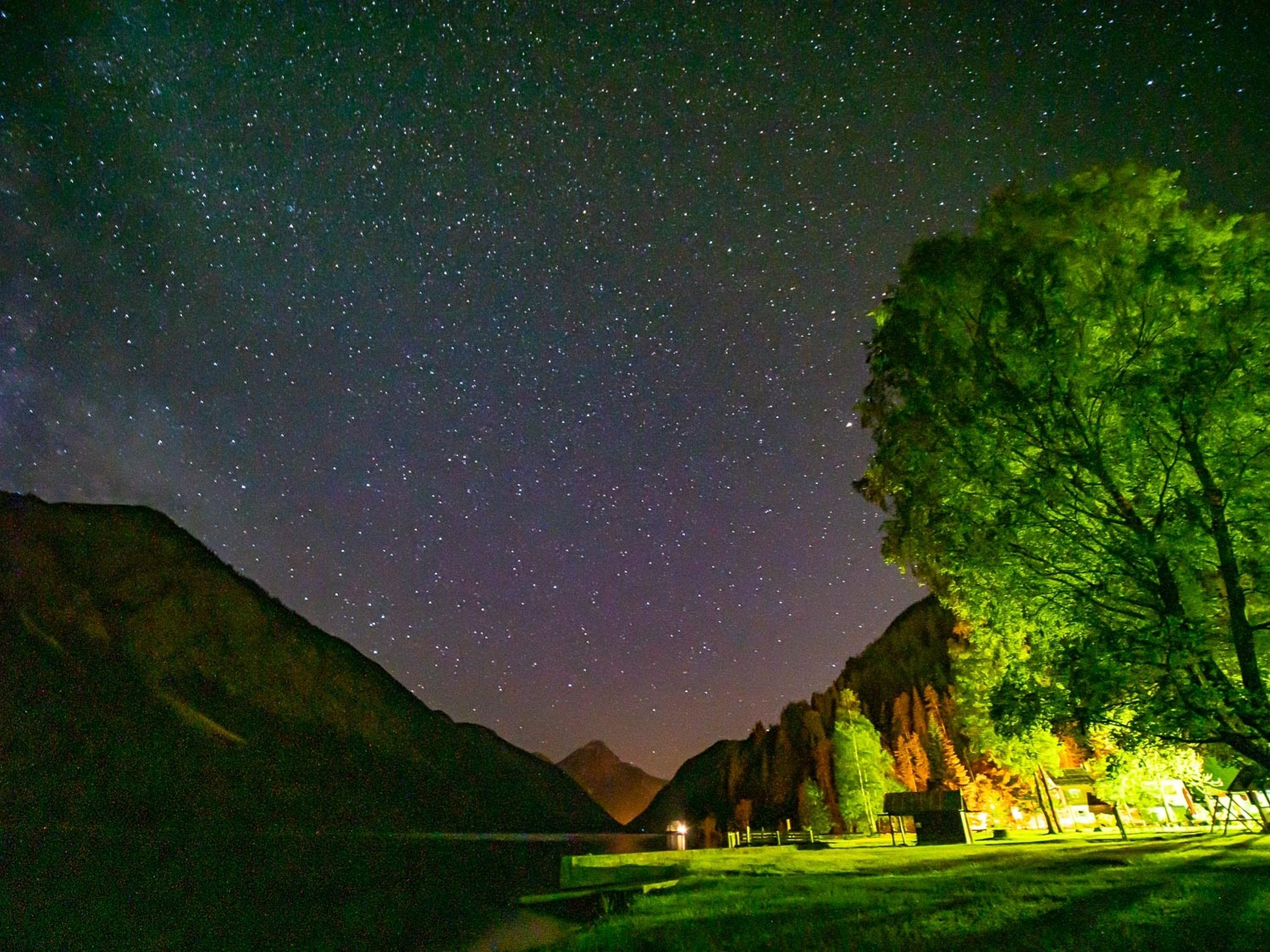 star - space, night, scenics - nature, space, beauty in nature, astronomy, sky, mountain, nature, tranquil scene, tranquility, star, star field, no people, plant, galaxy, green color, tree, water, idyllic, outdoors