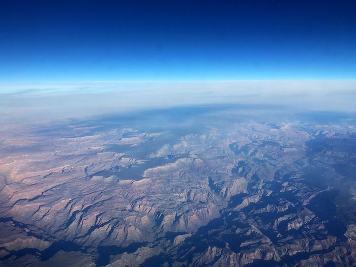 Aerial View Sky Blue Cloud - Sky Environment Nature Scenics - Nature Beauty In Nature Landscape Planet Earth High Angle View Cloudscape No People High Up Outdoors Copy Space Wind